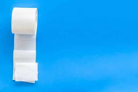Disease of colon. Toilet paper for proctology diseases concept on blue background top view mockup