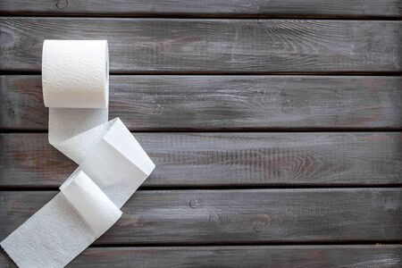 Disease of colon. Toilet paper for proctology diseases concept on wooden background top view mockup