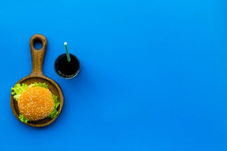 National American food concept with burgers and drink on blue background top view copyspace Stock fotó