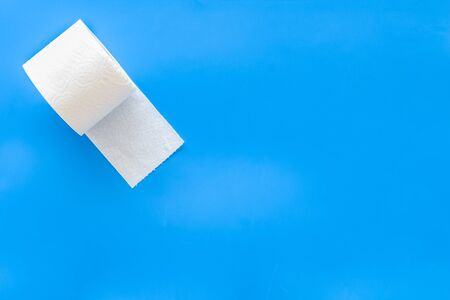 Toilet paper for proctology diseases concept on blue background top view mockup Stock Photo