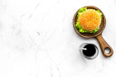 USA cuisine. Burger and drink for national American kitchen concept on white background top view mock up
