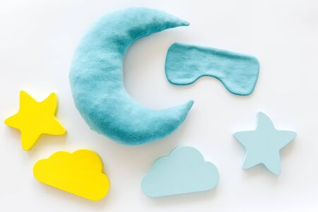 Good dreams. Night sleep concept with moon, clouds, stars toys and blindfold on white background top view Imagens