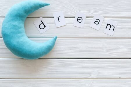 Good night. Dream concept with text and moon on white wooden background top view space for text