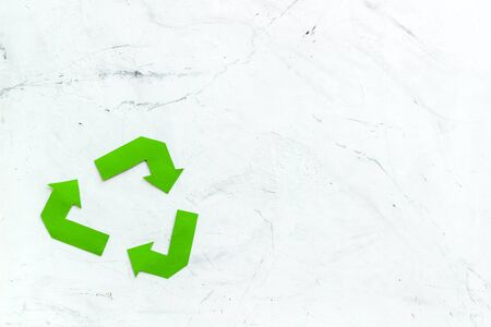 Garbage disposal. Green recycling sign for eco concept on marble background top view space for text