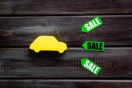 Discount in shop. Sale labels and car figure on white background top view