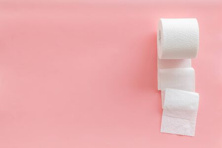 Disease of colon. Proctology concept with toilet paper on pink background top view space for text
