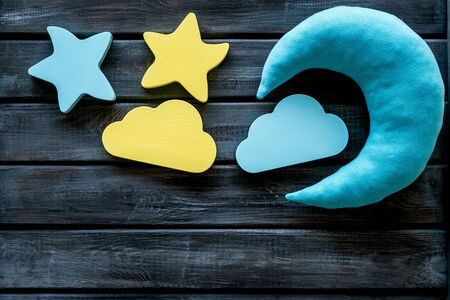 Good dreams. Night sleep concept with moon, clouds, stars toys on wooden background top view Banque d'images - 126731800