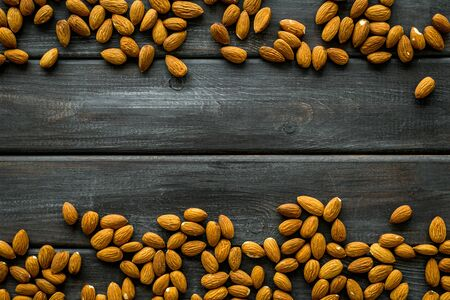 Healthy snack with almonds on wooden background top view mock up. Stock fotó