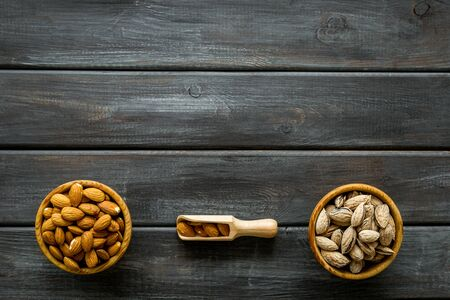Healthy snack with almonds on wooden background top view mock up. 写真素材