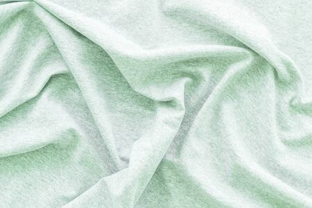 Pattern for blog with mint green fabric texture top view copyspace