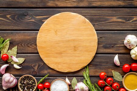Cutting board in frame of food for chef work on wooden background top view space for text
