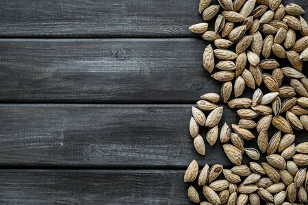Healthy snack. Almond for cooking on wooden background top view mockup Stock fotó