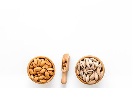 Healthy snack. Almond in bowls for cooking on white background top view mockup