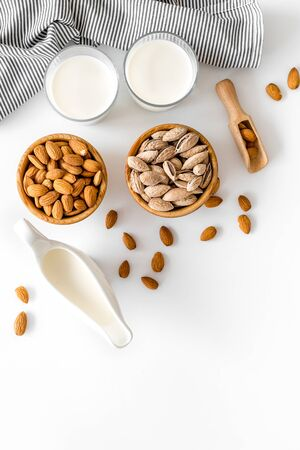 Healthy snack. Almond for cooking milk on white background top view mockup Stock fotó