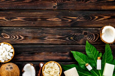 Face, body and hair treatment. Organic cosmetics with coconut oil, soap on wooden background top view mockup