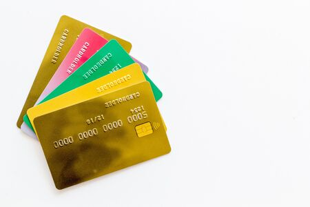 Business with credit cards close up on office desk white background top view mockup. 版權商用圖片