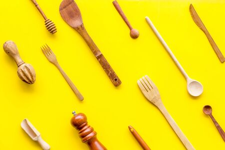 Tools and equipment for cooking. Pattern of cookware for chef work on yellow background top view. Stock Photo
