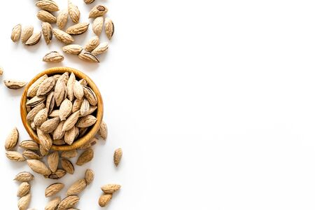 Healthy snack with almonds on white background top view mock up Stock fotó