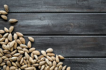 Healthy snack. Almond for cooking on wooden background top view mockup 写真素材