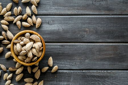 Almond in bowls for cooking on wooden background top view mockup 写真素材
