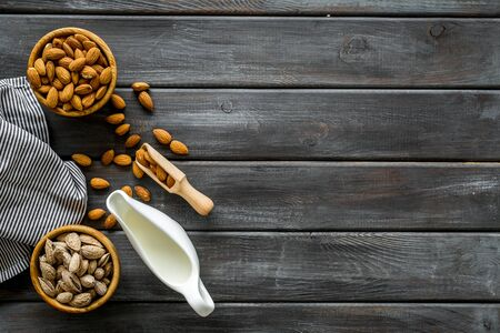 Healthy snack. Almond for cooking milk on wooden background top view mockup