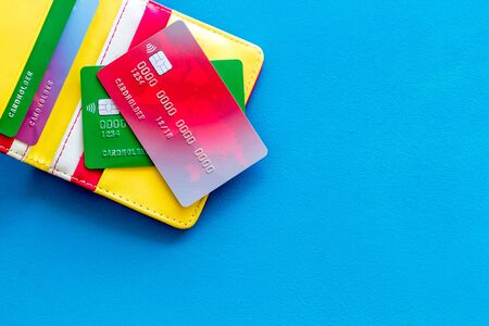 Business with credit cards and wallet on office desk blue background top view mock up 版權商用圖片