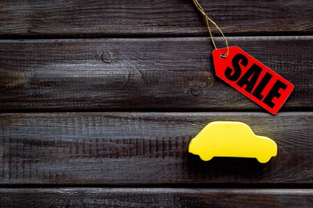 Sale for cars in shop with label and figure on wooden background top view mockup