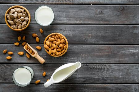 Almond milk in glass with almonds on wooden background top view copyspace 写真素材