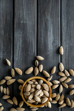Almond in bowls for cooking on wooden background top view mockup Stock fotó