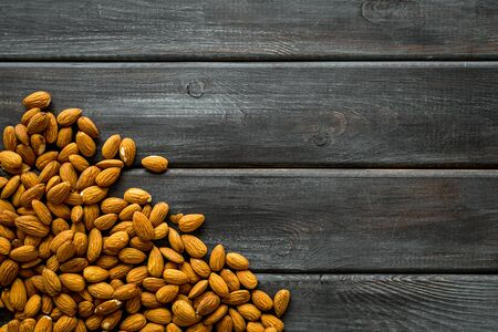 Healthy snack with almonds on wooden background top view mock up 写真素材