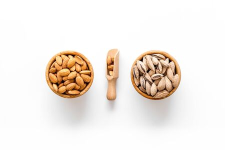 Nuts for snack. Almond in bowl on white background top view