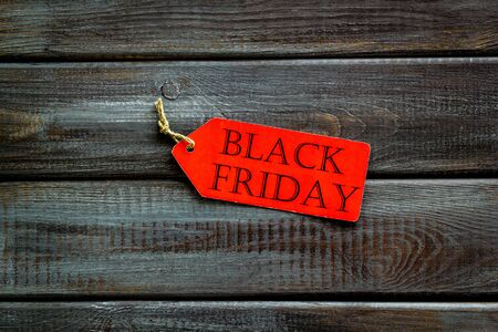 Discounts with black Friday label on wooden desk background top view 免版税图像
