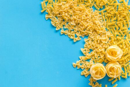 Organic homemade Italian pasta for restaurant on blue table background top view space for text Stok Fotoğraf