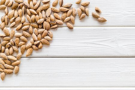 Healthy snack with almonds on white wooden background top view mock up