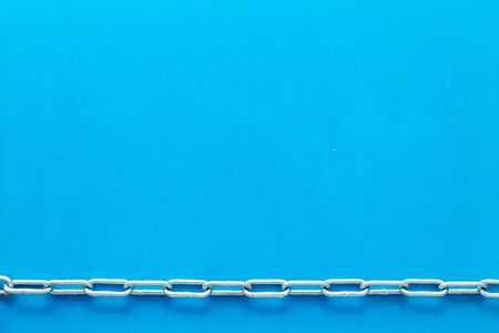 Chain for protection concept on blue background top view mockup 免版税图像