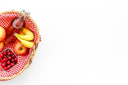 picnic in summer with products, apples, banana, cherry, drinks on white background top view space for text Stock Photo
