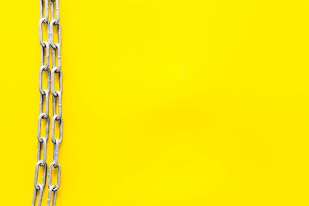 Chain for protection concept on yellow background top view mockup