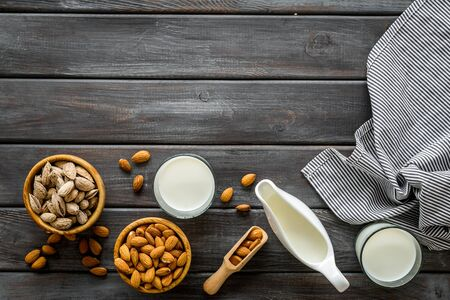 almond for cooking milk on wooden background top view mockup