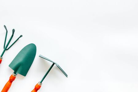Gardening tools on white background top view mockup