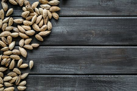 Almond on wooden background top view space for text 写真素材
