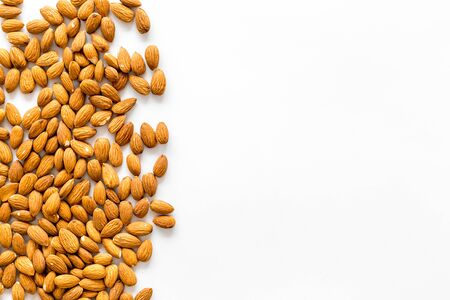 Nuts for snack. Almond on white background top view space for text