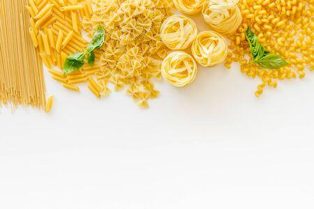 Mediterranean restaurant. Italian pasta on white table background top view mock up