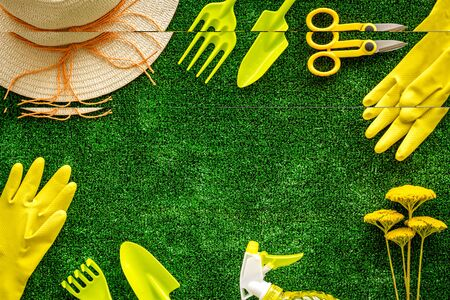 Gardening tools frame on green grass background top view space for text Stock Photo