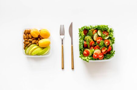 healthy fresh meal in lunch box to take away on white background top view