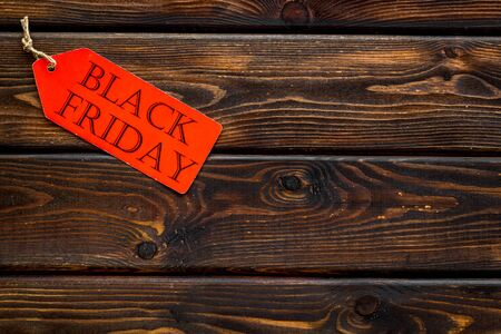 Black friday in shop with lable on wooden desk background top view mock up