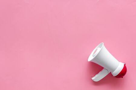 Attract attention with megaphone on pink background top view copyspace