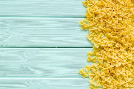 Italian pasta on mint green wooden table background top view mock up Stok Fotoğraf