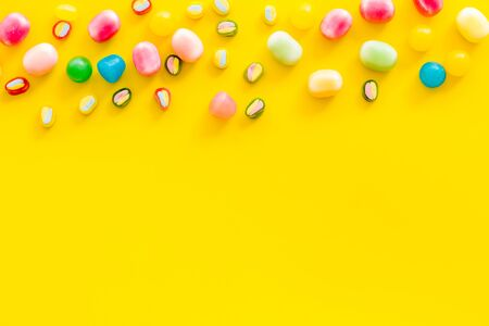 Sweets pattern on yellow background top view copyspace