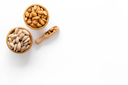 Almond in bowl on white background top view space for text