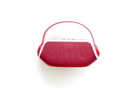 Wireless speaker as music gadgets on white background top view
